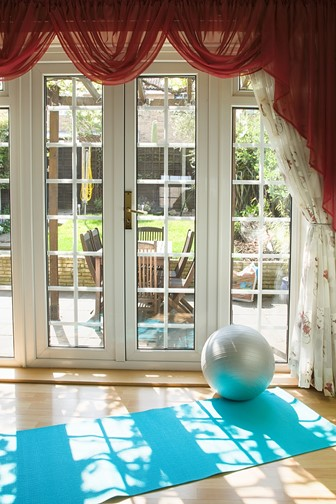 home gym with exercise mat and rubber gym ball