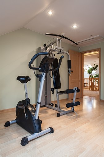 gym equipment in a large, modern house